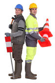 Building workers standing on white background — Stock Photo