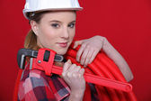 Female plumber equipped to fix problem — Stock Photo