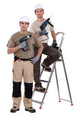Two craftsmen holding drills — Stock Photo