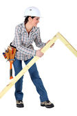 Female carpenter with wooden frame — Stock Photo