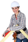 Female carpenter using a planer. — Stock Photo