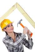 Woman building truss — Stock Photo