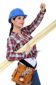 A female carpenter pointing at something. — Stock Photo