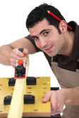 Carpenter sanding — Stock Photo
