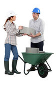 Male and female bricklayers working together — Stock Photo