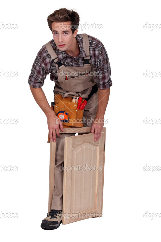 Carpenter making a window — Stock Photo #10325353