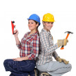 Duo of happy craftswomen back to back — Stock Photo