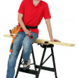 Carpenter sitting on a workbench — Stock Photo #10344386