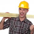 Stock Photo: Cheeky carpenter giving thumbs-up