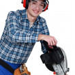 Stock Photo: Tradesman using a circular saw