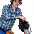 Stock Photo: Tradesmusing circular saw