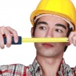 Stock Photo: Young craftsmtape measure