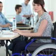 Young womdisabled at work — Stock Photo #10346259