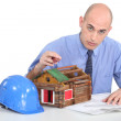 Architect sat with model house — Stock Photo