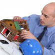 Man building a house model — Stock Photo