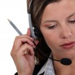 Brunette call-center worker listening to customer — Stock Photo #10347284