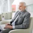 Senior businessman waiting in airport — Stock Photo #10347664