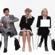 Business sitting in a row - Stock Photo