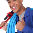 Royalty-Free Stock Photo: Young plumber with a wrench