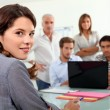 Students gathered around laptop in class — Stock Photo #10349085
