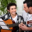 Father and son with acoustic guitar — Stock Photo