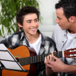 Father and son with acoustic guitar - Stock Photo