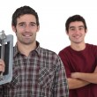 A team of tile fitters holding tools — Stock Photo #10349335