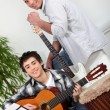 Teenage boy having guitar lesson — Stock Photo