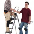 Craftsman and apprentice shaking hands — Stock Photo #10349353