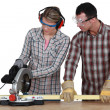 Apprentice with circular saw — Stock Photo #10349428