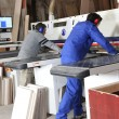 Two men using factory equipment — Stockfoto