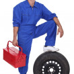 Mechanic with wheel — Stock Photo #10349593