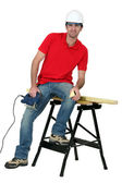 Man cutting a piece of wood with a jigsaw — Stock Photo