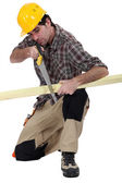 Carpenter with a handsaw — Stock Photo