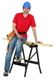 Carpenter sitting on a workbench — Stock Photo