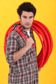 Craftsman wrench and hose reel — Stock Photo