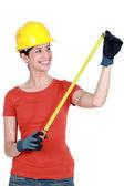 Woman using tape measure — Stock Photo