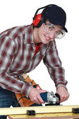 Young carpenter at work on workbench — Stock Photo