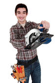 Craftsman holding an electric saw — Stock Photo
