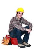 Artisan sitting on toolbox — Stock Photo