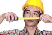 Young craftsman tape measure — Stock Photo