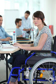 Young woman disabled at work — Stock Photo
