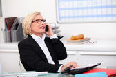 Senior saleswoman hasn't lost her touch — Stockfoto