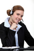 A businesswoman with a headset on. — Stock Photo