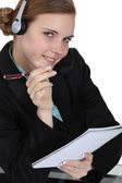 A businesswoman answering a hotline. — Stock Photo