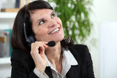 Businesswoman with a headset — Stock Photo