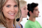 Row of call-center workers — Stock Photo