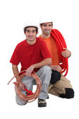 Plumbers with traditional copper and modern plastic pipe — Stock Photo
