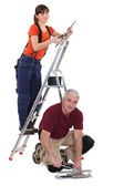 A team of tradespeople at work — Stock Photo