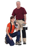 Tile cutter and female helper — Stock Photo